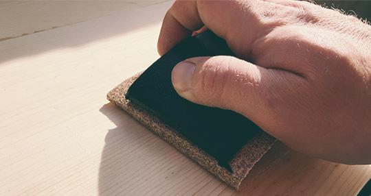 Sanding a piece of wood