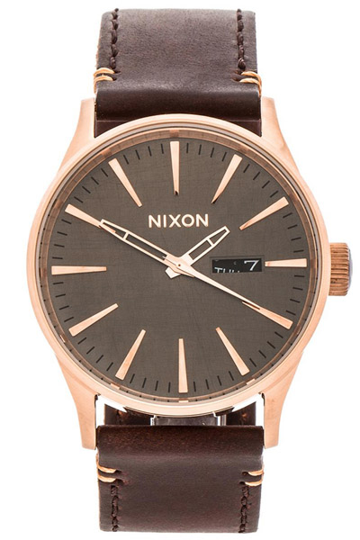 Nixon rose gold watch with brown strap
