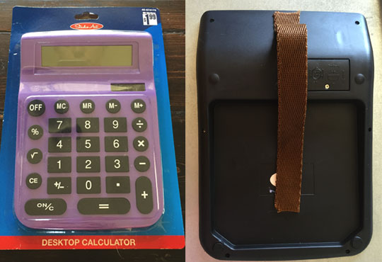 Front and back of calculator with strap attached