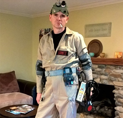 A man wearing a DIY Ghostbusters costume