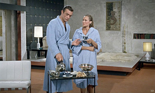 James Bond wearing a blue robe