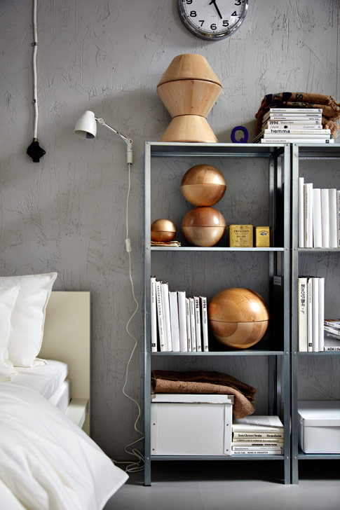 A bedroom with a bookshelf and bed