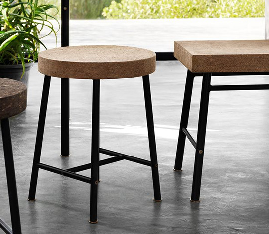 A wooden table with stool