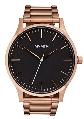 Gold MVMT watch with black face