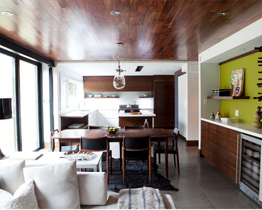 A living room filled with furniture with a wooden ceiling