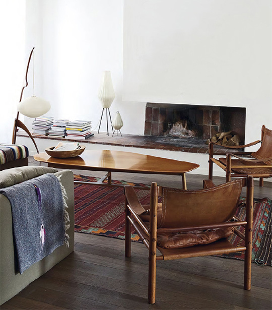 An eclectic  living room filled with furniture and a table