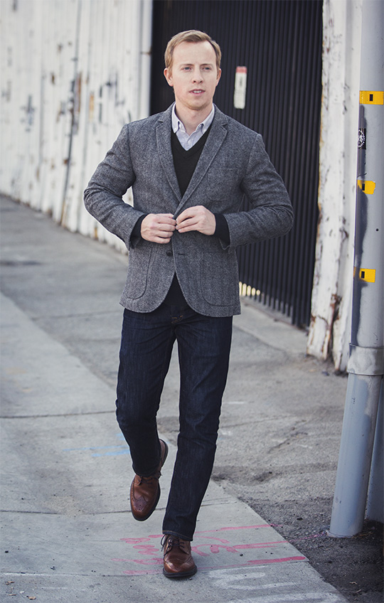 Herringbone blazer, black sweater, jeans, brown wingtip shoes
