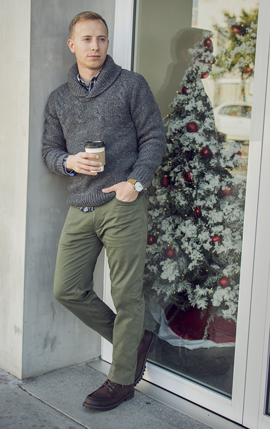 Man wearing shawl collar sweater and green pants