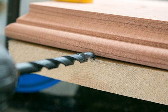 A drill bit going into wood