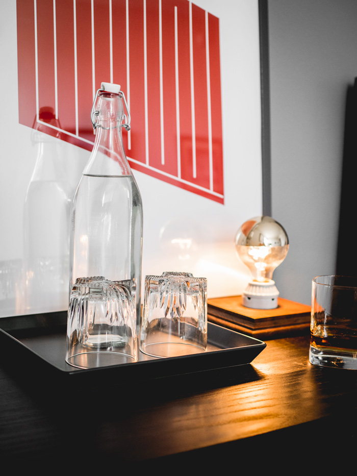 Water carafe and glasses in bedroom