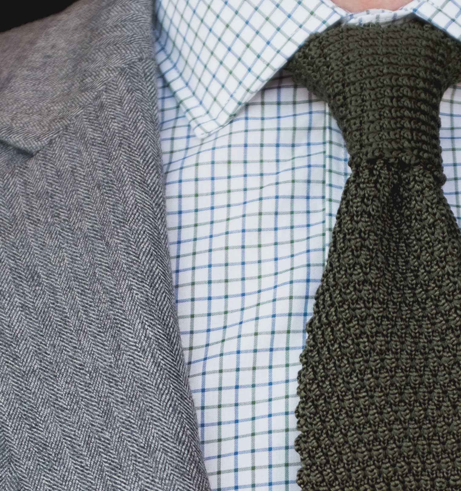Indochino Herringbone suit with knit tie