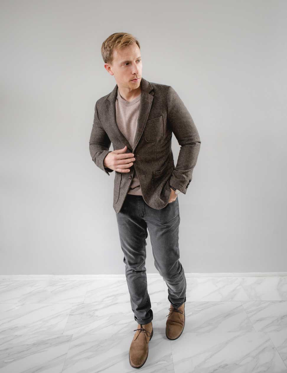 men tweed jacket over sweater gray jeans outfit inspiration