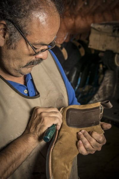 A craftsman in a Leon, Mexico factory hand builds a Thursday boot