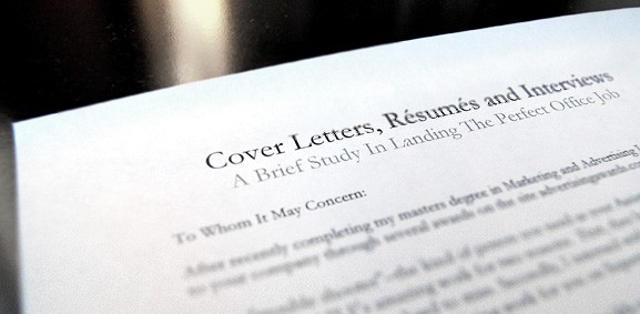 cover letters, resumes and interviews paper on table