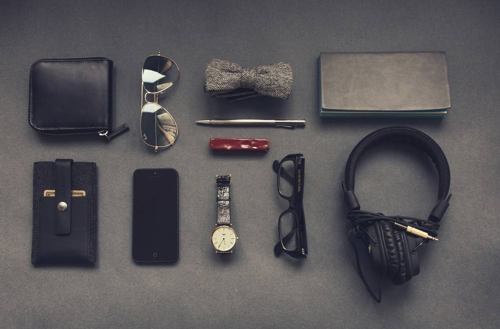 everyday carry gadget items on grey table