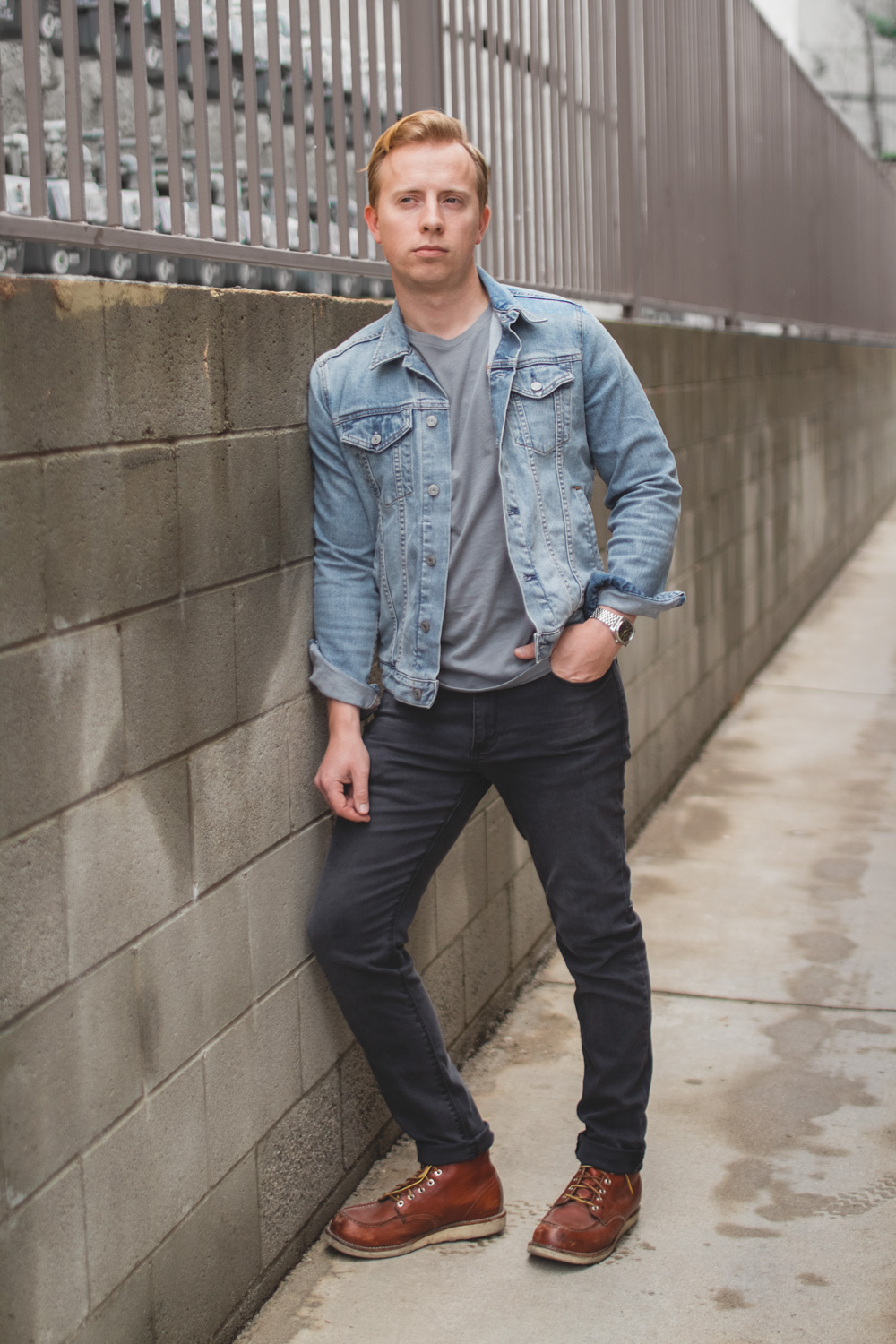 light blue denim jacket with gray jeans and red wings