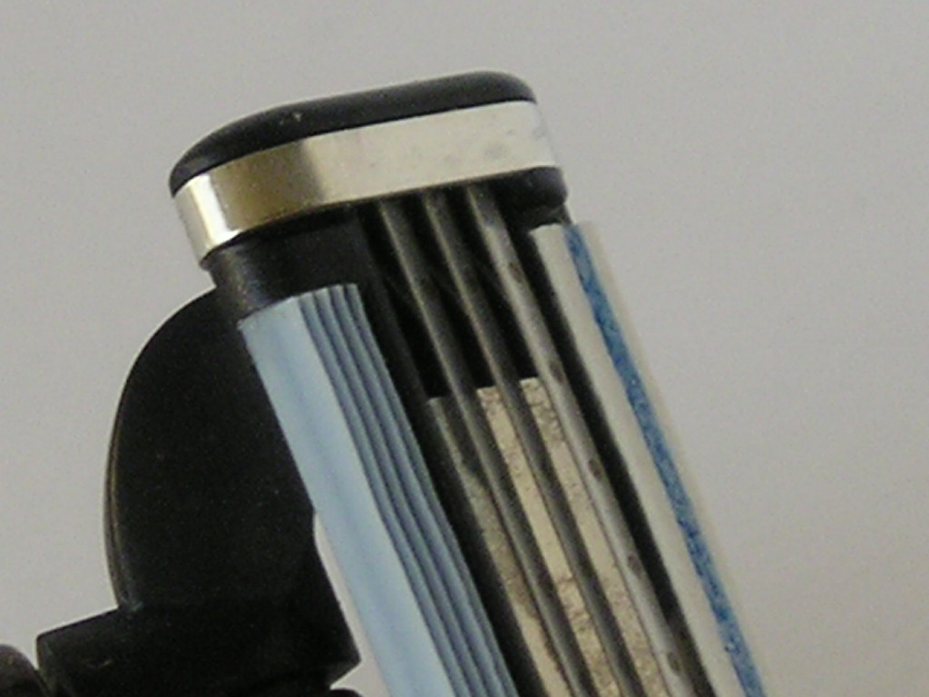 close up of multiblade razor shaving tips