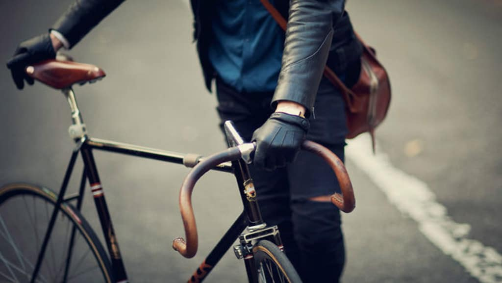 men black leather gloves with bicycle