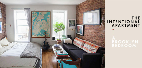 A living room with a brick wall