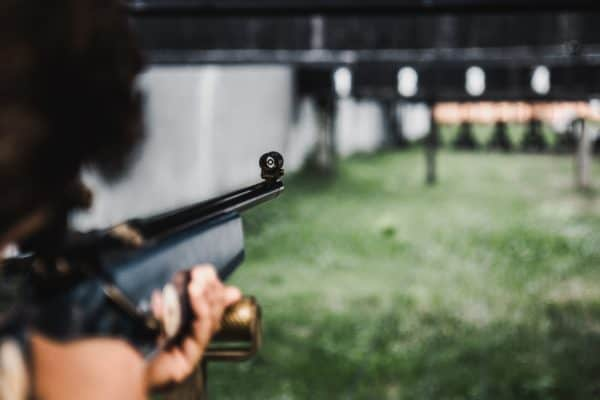 rifle aims at a shooting range in shallow focus