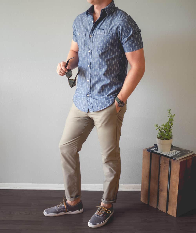 A man wearing khaki pants and a short sleeve shirt