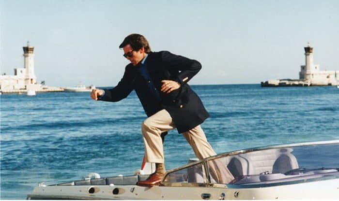 Pierce Brosnan as James Bond sports a blue blazer and tan khakis for a nautical look