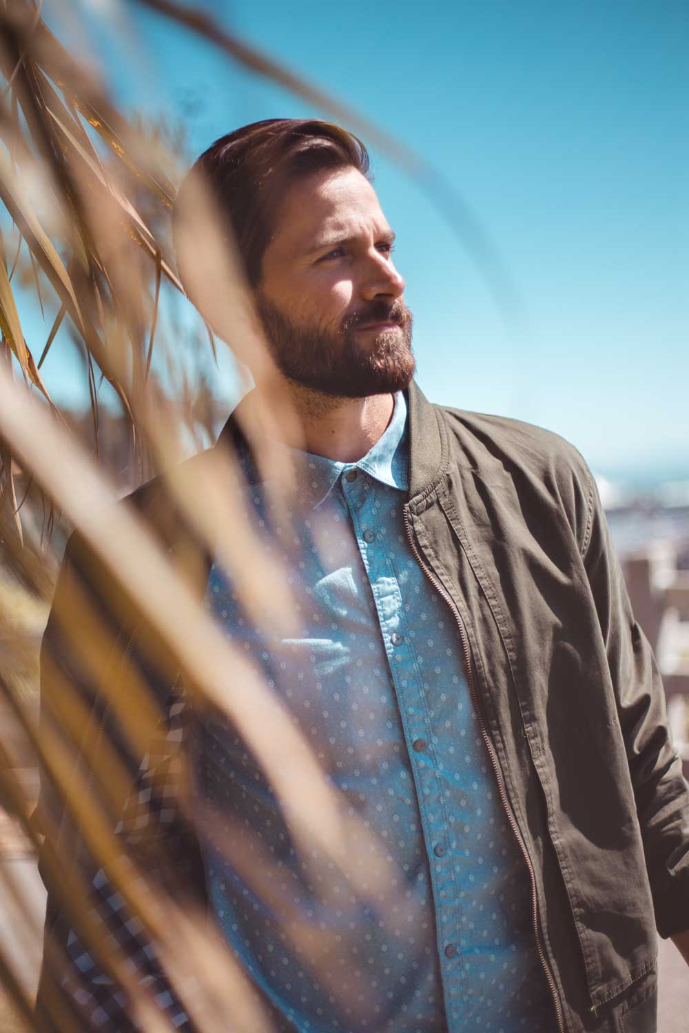 Photo of man wearing a jacket and button up shirt