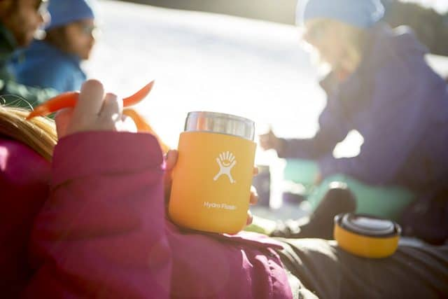 Shot of a young camper holding a hydro flask food flask