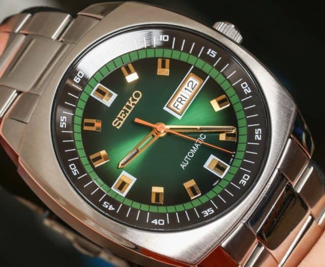 Close up of Seiko Men's Analog Green Dial Automatic Silver Stainless Steel Watch