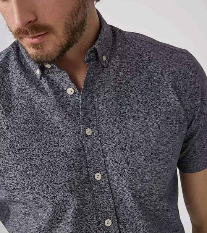 A man wearing a gray shirt