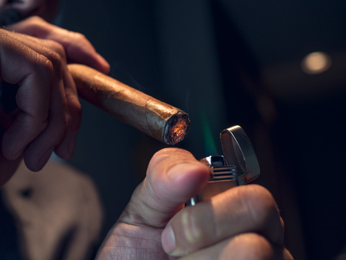 how to properly light a cigar with a lighter