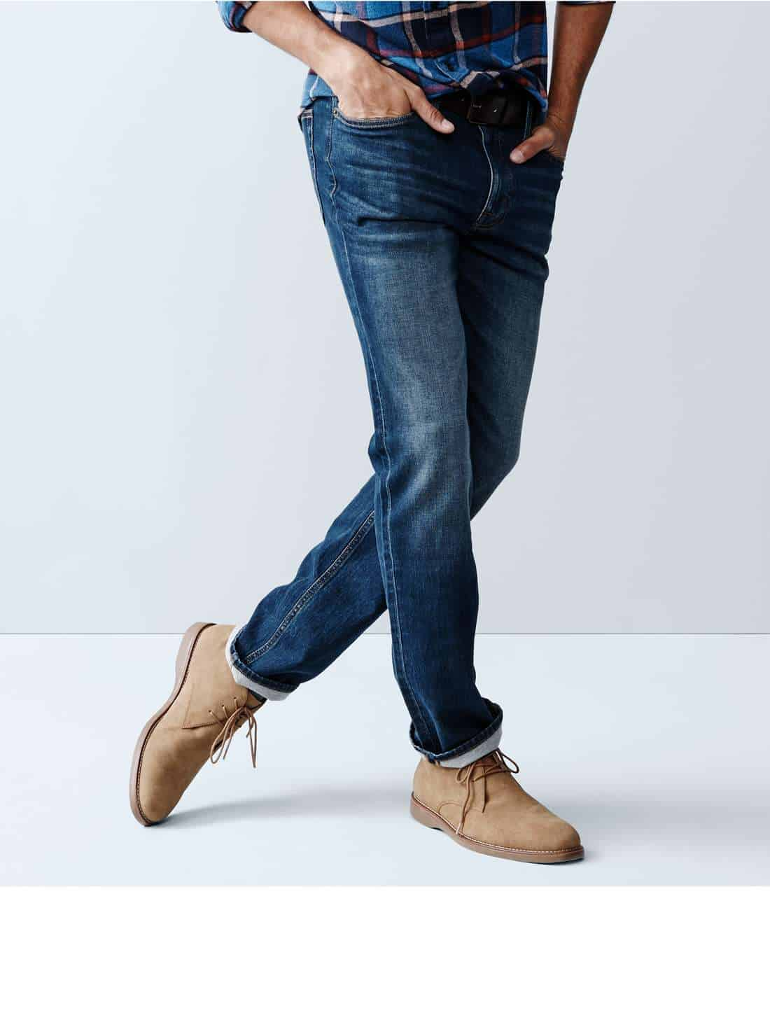 A man wearing medium blue jeans