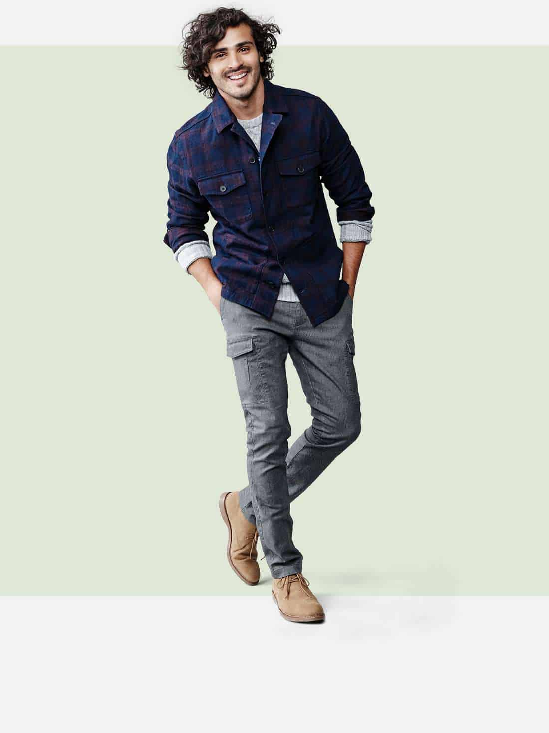 A man modeling shirts and pants from Target