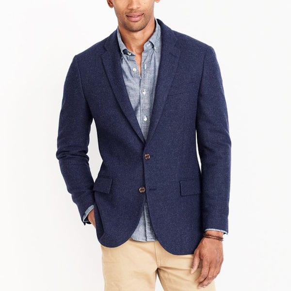 A man wearing a blue blazer