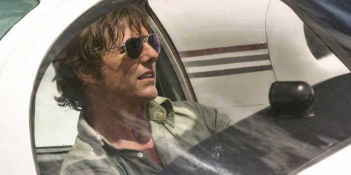Tom Cruise sitting in a car