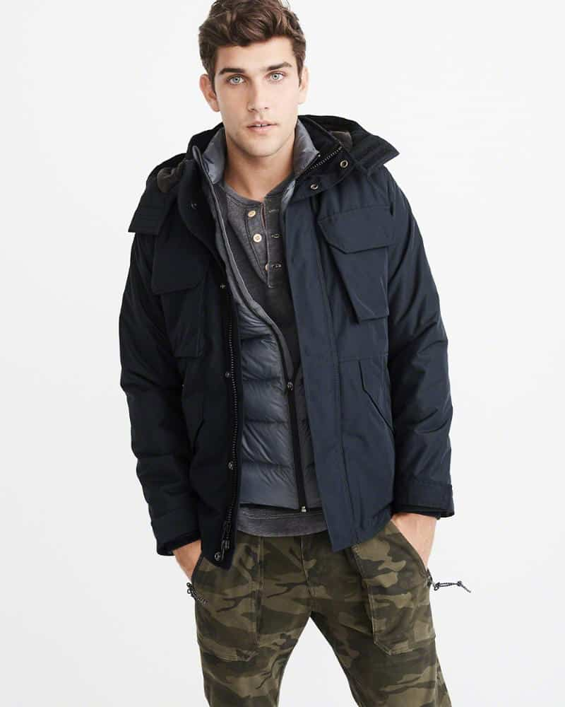 A person standing posing for the camera, with Technical Jacket