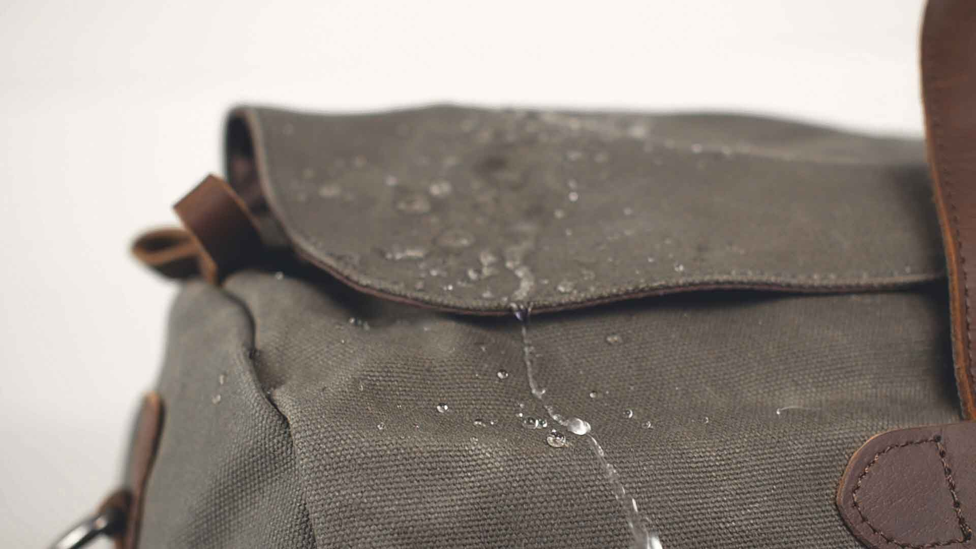 water running off of waxed canvas