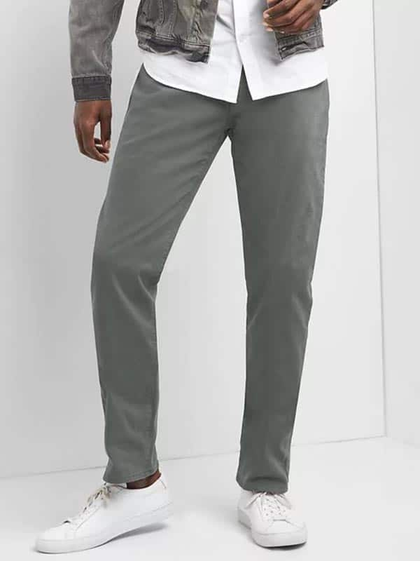 A person modeling gray pants
