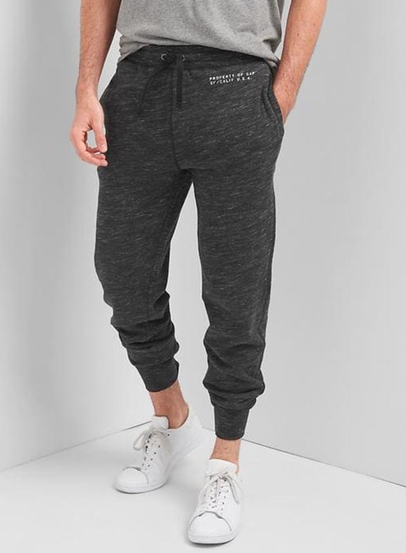 A person modeling sweat pants