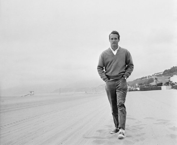 Paul Newman in a vintage photo wearing a v-neck sweatshirt