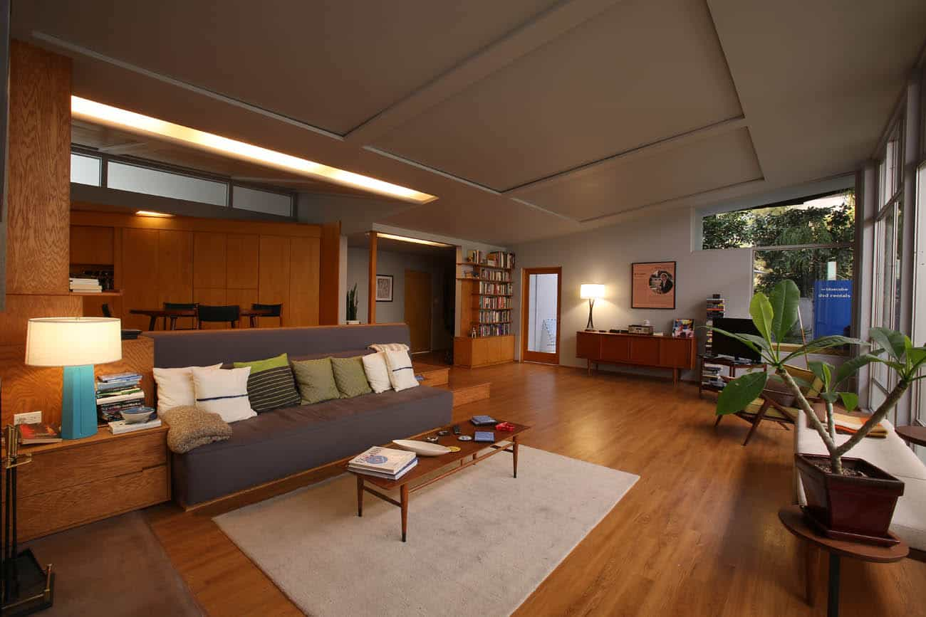 A living room filled with furniture with wood accents