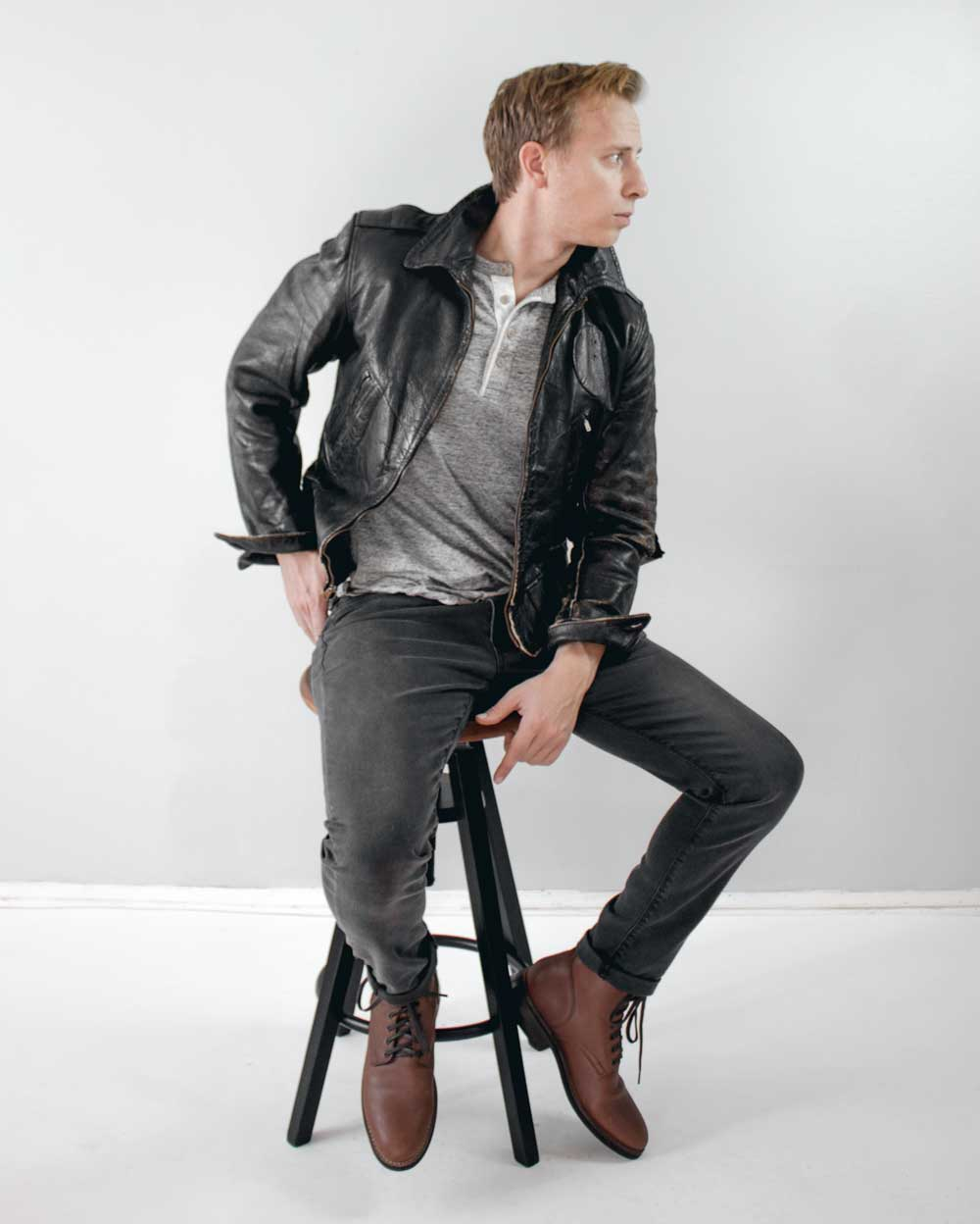 men street style leather jacket henley black jeans brown boots