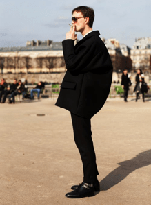 A model in Paris shows off the new trend in contrasting silhouette with slim jeans and a baggy coat