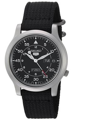 A close up of a seiko black watch