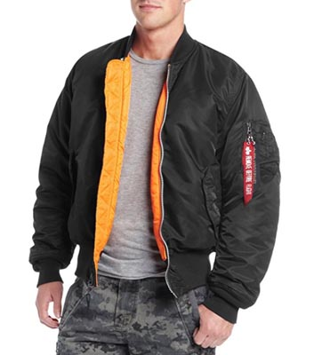 A person posing for the camera, with Alpha Industries bomber jacket