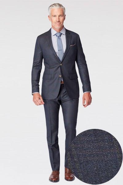 A man wearing a glen check suit