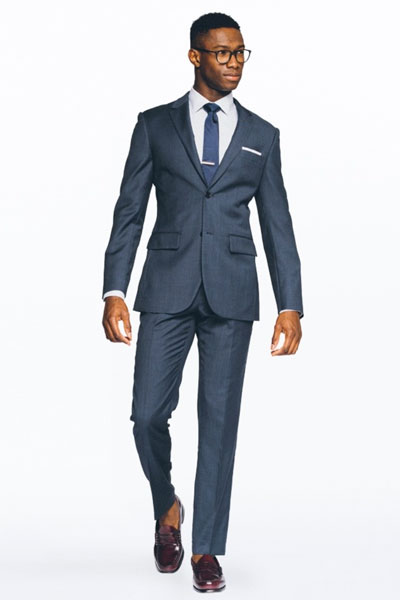 Man wearing blue suit and blue tie