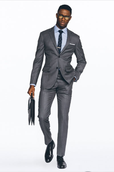 Man wearing charcoal suit