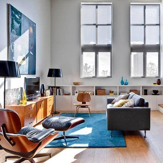 A room filled with modern furniture and a large window