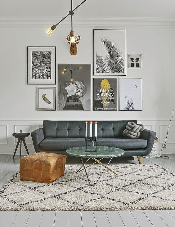 A living room with lots of art on the wall